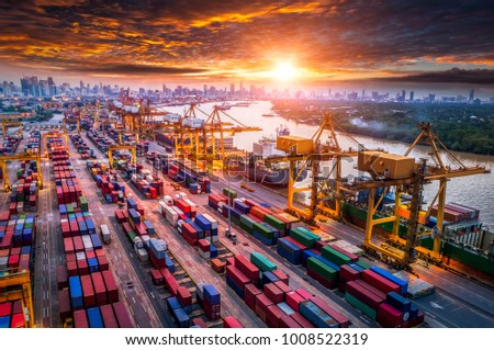 Logistics and transportation of Container Cargo ship and Cargo plane with working crane bridge in shipyard at sunrise, logistic import export and transport industry background #1008522319