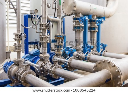 Water pump station and pipeline on roof deck of water tank for industrial work #1008545224