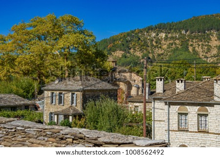 Spring colors and traditional architectural buildings at the picturesque mountainous village of Papigo, Epirus, Greece, Europe. #1008562492