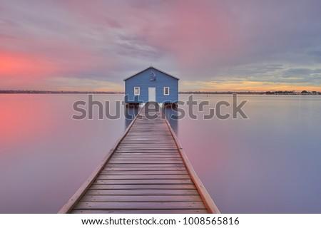 Dramatic sunrise over boathouse in the Swan River Perth, Australia                           #1008565816