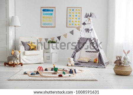 an empty children's playroom with tent and  toy railway  #1008591631