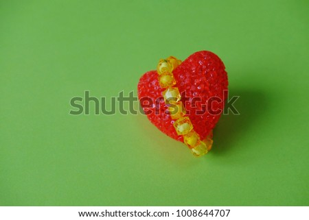 Red heart on green background, valentines day. #1008644707