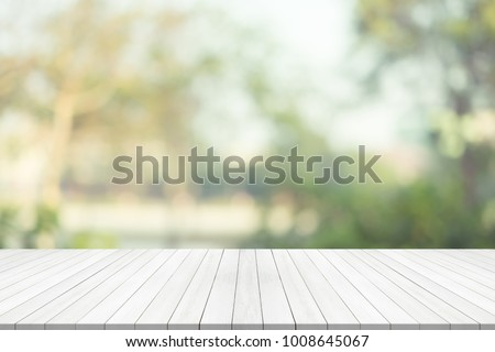 White wood table top on green blurred background,space for montage product #1008645067