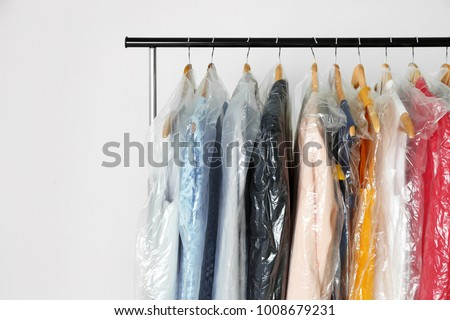 Hangers with clean clothes in laundry #1008679231