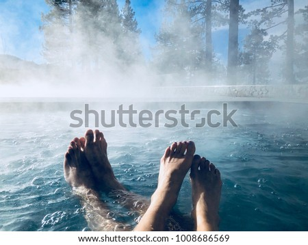 Couples Feet in Hot Tub Jacuzzi Spa Outdoors with Mist Romantic Getaway