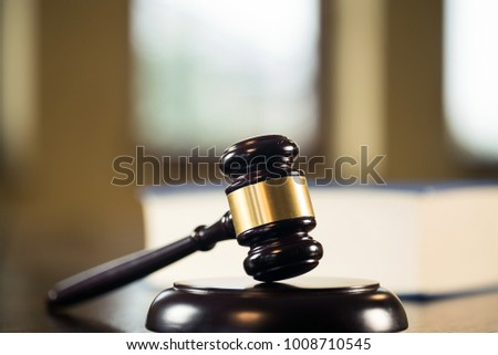 Law and Justice concept. Mallet of the judge, books, scales of justice. Courtroom theme. #1008710545