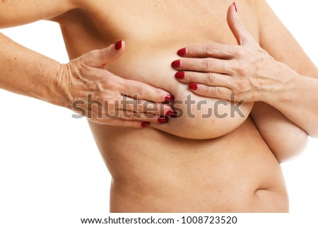 Picture showing adult woman examining breast over white background