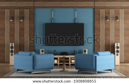 home cinema room with TV hanging on blue wall ,armchairs and wooden decorations - 3d rendering #1008808855