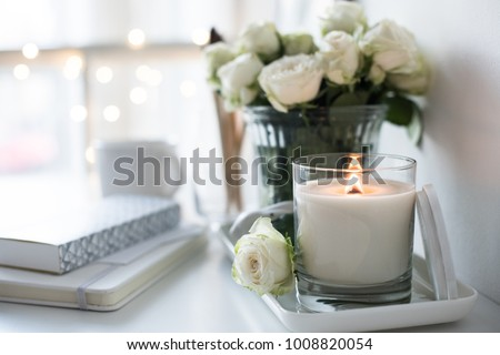 White room interior decor with burning hand-made candle and bouq Royalty-Free Stock Photo #1008820054