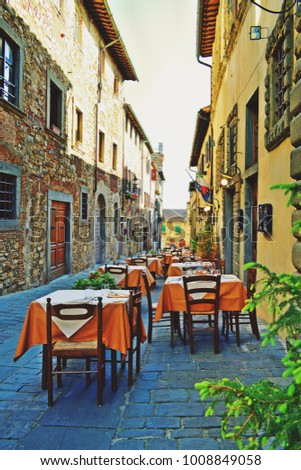 Italy, Florence, San Donato in Poggio, July 2017 characteristic outdoor restaurant in the medieval village of San Donato in Poggio in the municipality of Tavarnelle Val di Pesa in Florence Tuscany  #1008849058