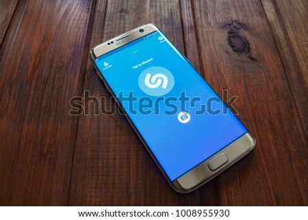 Kazan, Russian Federation - Sep 15, 2017: Samsung s7 Green with music service Shazam on the screen.  #1008955930