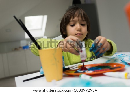 Little boy at home drawing and playing #1008972934