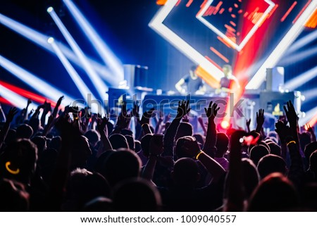 Dj party at nightclub. Crowd rave at the stage background. Stranger Dj's  #1009040557