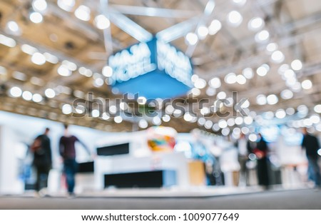 trade show booth, generic background with a blur effect applied #1009077649