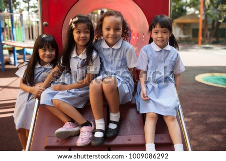 BANGKOK, THAILAND - NOVEMBER 22, 2012: In a college in Bangkok, children have fun in the playground during the break #1009086292