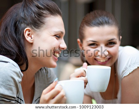 Young women having coffee #1009123003