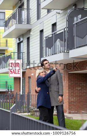 Couple looking at new apartment #1009126756