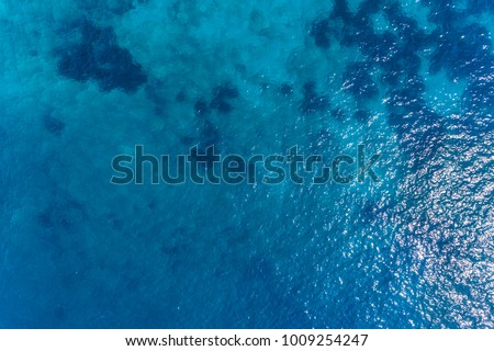 Aerial view on turquoise waves, water surface texture. #1009254247