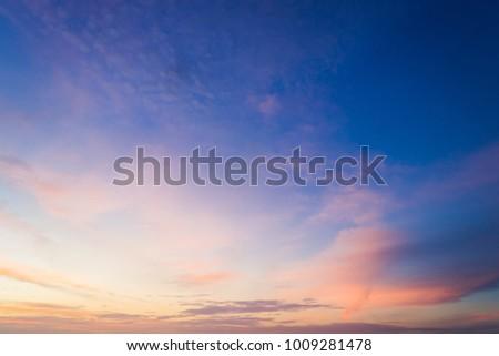 Dusk,Sunset Sky in the Evening,Dramatic and Wonderful Cloud on Twilight,Majestic Dark Blue Sky Nature Background,Colorful Cloud on summer season,Idyllic Peaceful Sunlight. Royalty-Free Stock Photo #1009281478