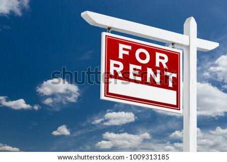 Left Facing For Rent Real Estate Sign Over Blue Sky and Clouds With Room For Your Text.