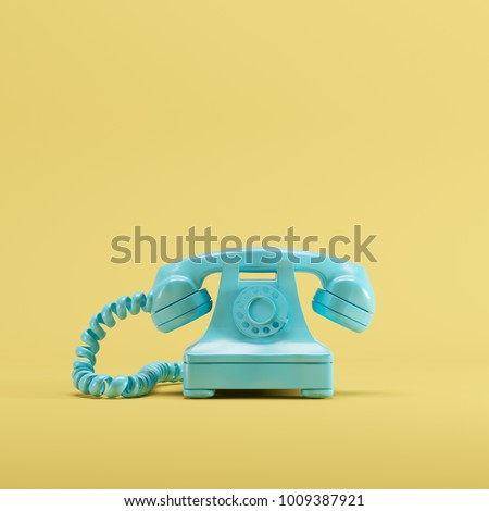 Blue vintage telephone on yellow pastel color background. minimal idea concept. Royalty-Free Stock Photo #1009387921