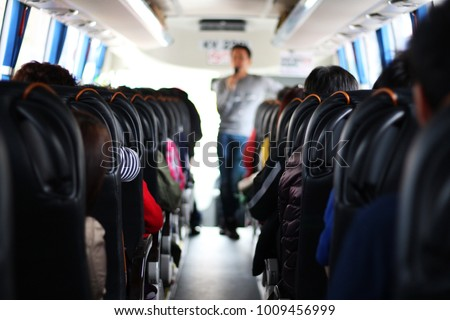 The passengers in the bus which are tourists and guide  #1009456999