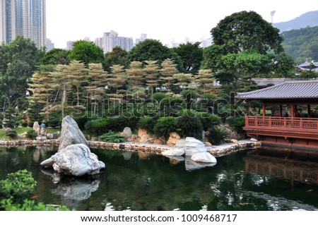 Lake and large stones in the botanical garden of Hong Kong #1009468717