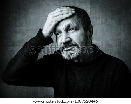 Sad elderly bearded man black and white portrait #1009520446