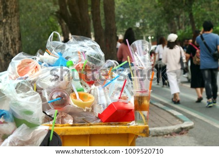 Garbage plastic Waste trash full of trash bin yellow and background people are walking on the sidewalk garden, Garbage bin, Trash plastic pollution, Garbage, Waste, Plastic Waste #1009520710
