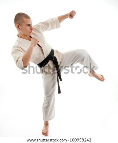 Karate. Man in a kimono on the white background #100958242
