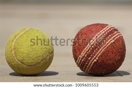 Used cricket ball and tennis ball #1009605553