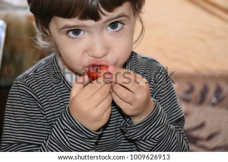 the child eats strawberries  #1009626913
