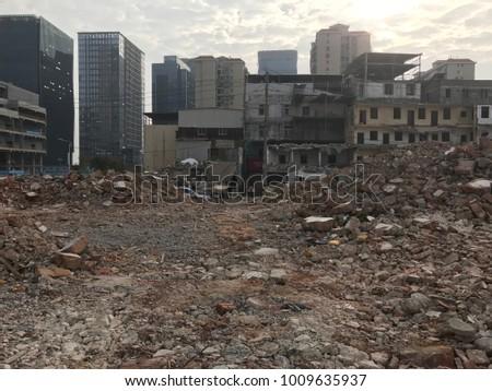 Demolish building with debris in city, broken house on ruin demolishing site after destruction #1009635937