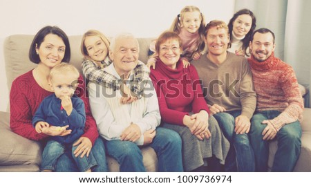 Family members making family photo during reunion party on sofa