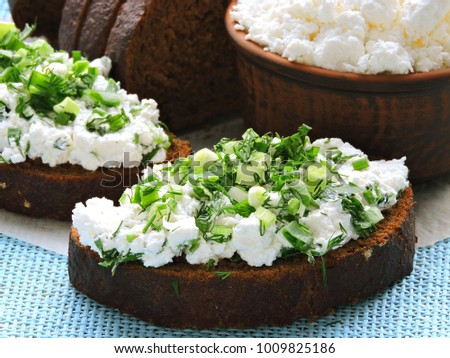 Curd sandwiches with fresh herbs. Fresh rye bread with cottage cheese and green herbs. Concept proper snack.  #1009825186