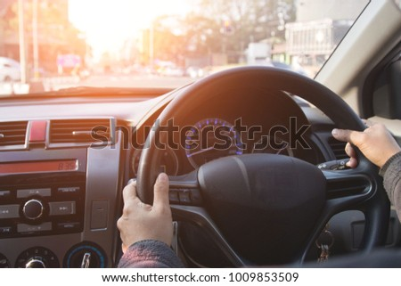 Women are using their hands to drive for directions to work in the morning. #1009853509
