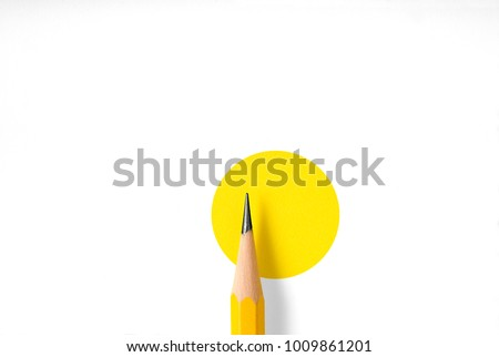 Minimalist template with copy space by top view close up macro photo of wooden yellow pencil isolated on white texture paper and combine with yellow circle. Flash light made smooth shadow from pencil. #1009861201
