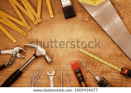 Assorted work tools on wood #1009934077