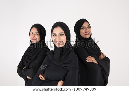 Arab women in traditional dress standing on white background #1009949389