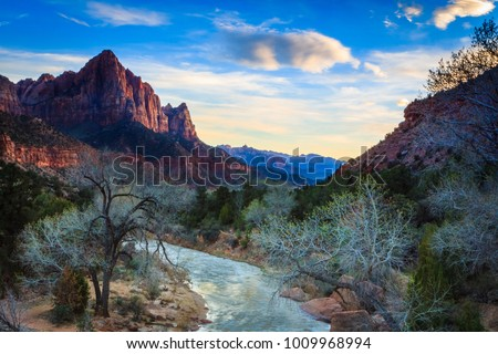 The Virgin River Flows Towards The Watchman at Sunset #1009968994