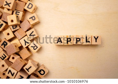 Apply word cube on wood background #1010106976