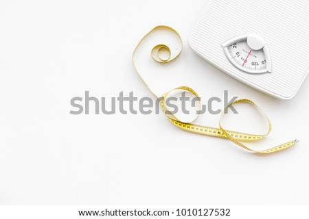 Slim concept. Scale and measuring tape on white background top view space for text #1010127532