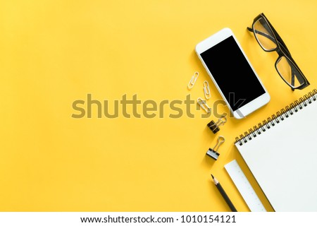 Mock up smartphone and office accessories on colorful background with copy space.view from above #1010154121