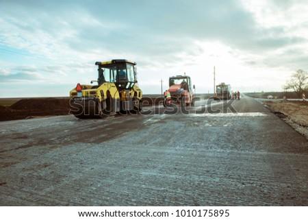Road roller building the new asphalt road #1010175895