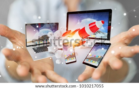 Businesswoman on blurred background connecting tech devices and startup rocket 3D rendering #1010217055