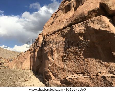 Pre-historic petroglyphs near Talabre, San Pedro de Atacama, Antofagasta, Chile #1010278360