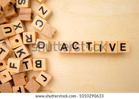 Active word cube on wood background #1010290633
