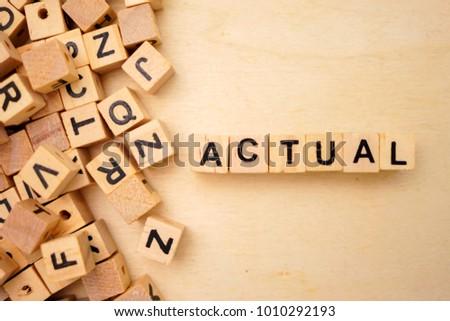 Adjust word cube on wood background #1010292193