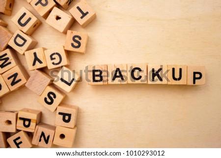 Backup word cube on wood background #1010293012