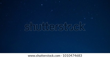 very beautiful panorama night blue sky and star background.with grain and select white balance.